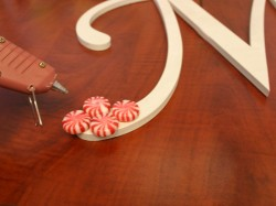 How to Create a Peppermint Candy Monogram Wreath | gluing-2 | CraftCuts.com