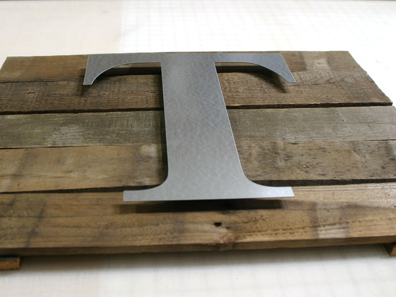 create a rustic wall plaque using metal craft letters glue the letter in place